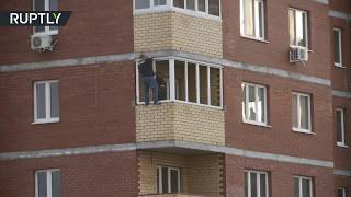 Meanwhile in Russia: Man tries to install 12th floor window with no safety harness