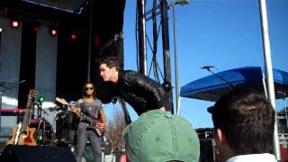 Andy Grammer taking a photo with the crowd