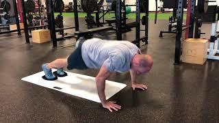 EricCressey.com: Slideboard Yoga Push-up