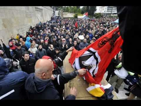 Greek protesters burn German flag chant 'Nazis Out'