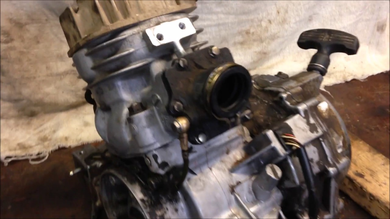 Step 9: How to Install Polaris 300 350 400L Top End Cylinder Piston Head  Intake Exhaust Manifold