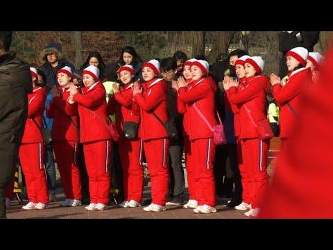 North Korean cheerleaders perform at historical house