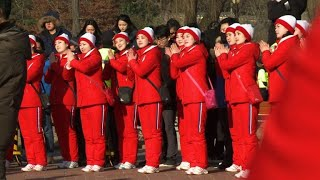 North Korean cheerleaders perform at historical house
