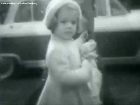 November 27, 1960 - President Elect John F. Kennedy takes his daughter Caroline to Church
