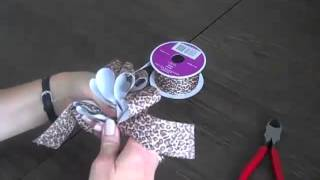 How to Make a Bow from Fabric Ribbon Learn how to make a bow using ...