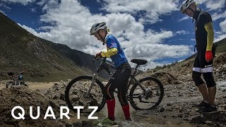A 12-year-old is biking one of the hardest routes in China