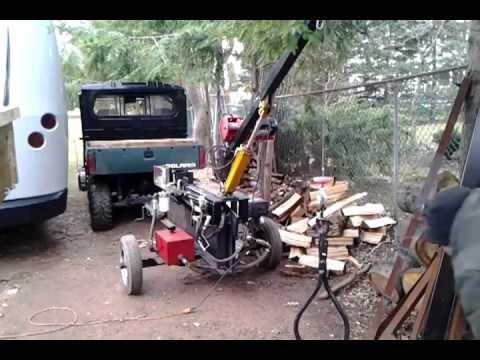 Log splitter with crane.