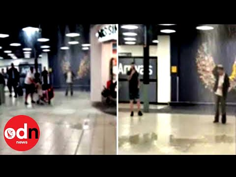 Heavy Rain Pours Inside London Luton Airport During Power Cut