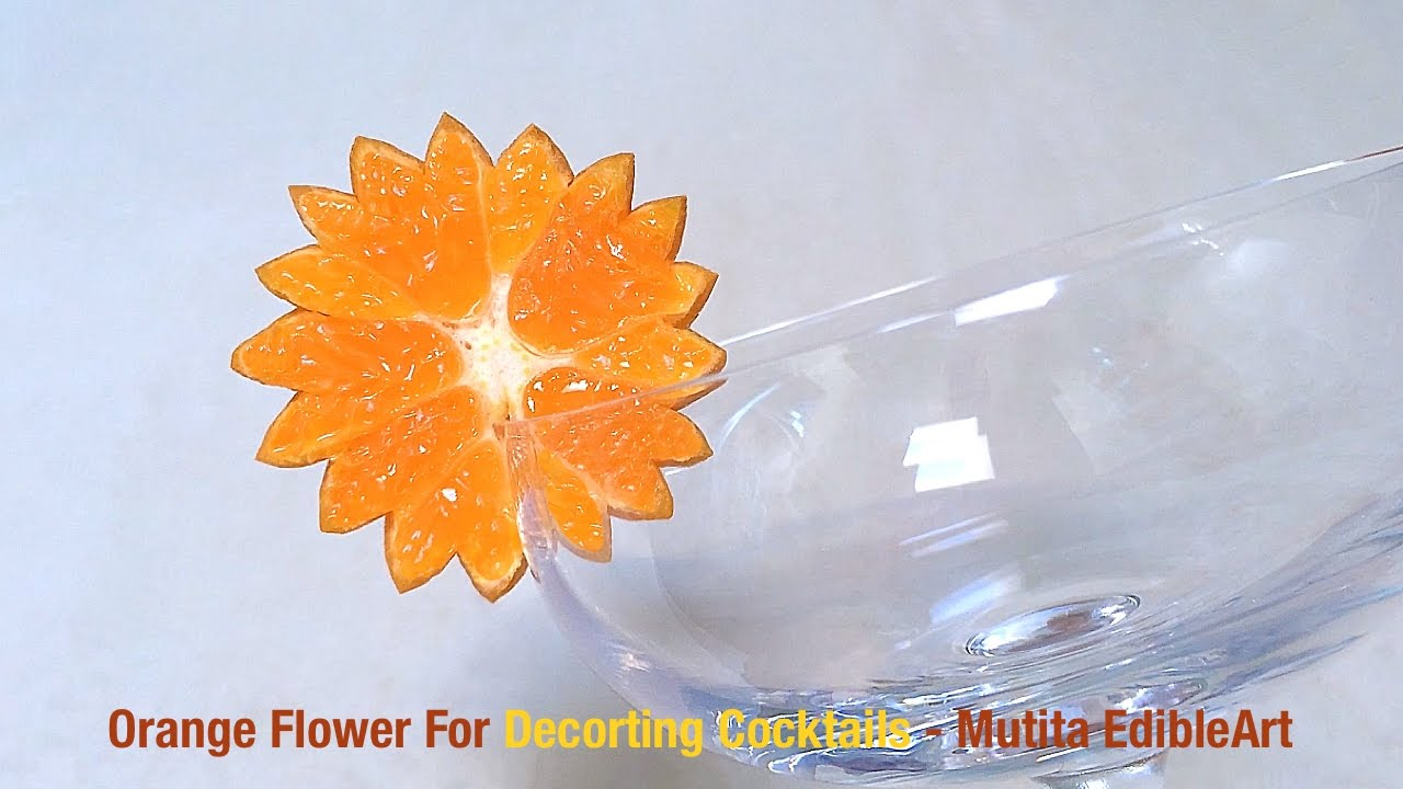Simple orange flower for decoration garnish cocktails for Fruit orange decoration