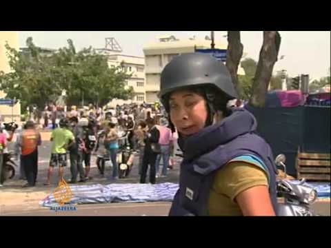 Dozens injured as Thai police clear protest sites