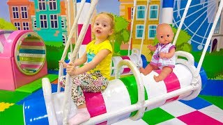 Stacy at new Indoor Playground with baby doll