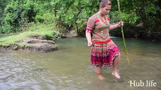 Primitive life : find fish meet big fish, smart girl catching big fish by the river