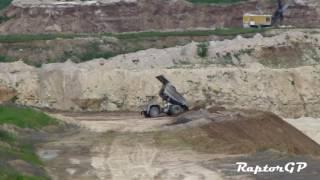 BELAZ-7547 mining truck is dumping clay. Разгрузка глины самосвалом БелАЗ-7547