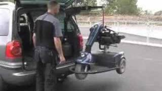 Lifting a scooter into a car with a Carolift hoist