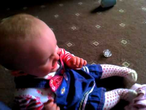 Baby girl laughing untill she fall down
