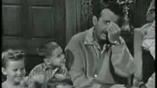 Ernie Ford - singing with a little boy by his side.  Pretty funny.