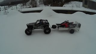 Rc snowmobile polaris rush on trailer and ride.