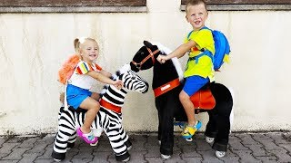 Unboxing new Ponycycle Horse and Zebra Toys by little girl Elis and Thomas - Ride On Toys for kids
