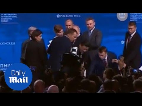 China's President Grabbed By Security As He Almost Tumbles Off Stage
