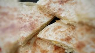 Delicious stuffed paratha with spicy eggs