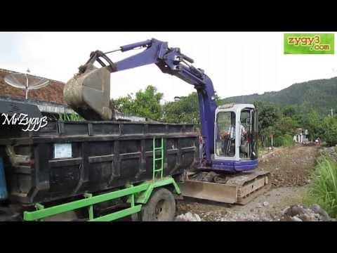 Excavator Komatsu PC75UU Loading Dump Truck Toyota Dyna Rino
