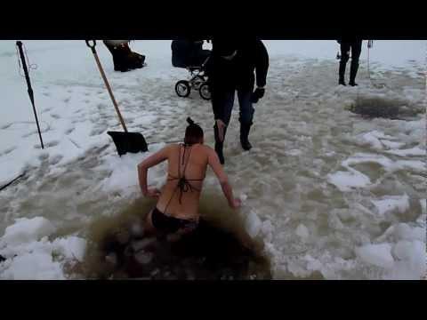 brave girl winter swimming under ice in Estonia