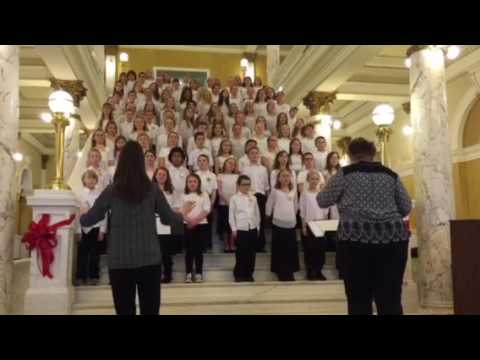 Jacob sings at South Dakota capital building, with other Aberdeen students. 2017