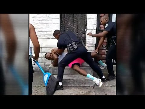 Baltimore officer resigns after video shows him punching man