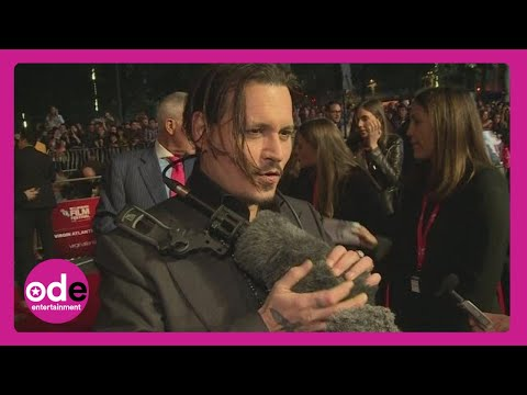 Johnny Depp fondles fluffy mic at London Film Festival's Black Mass premiere