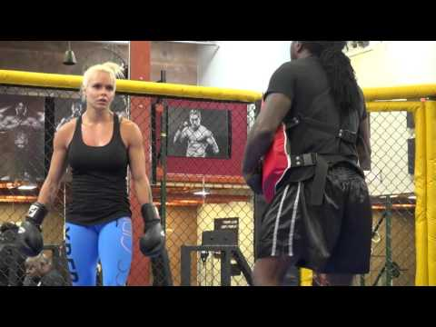 Fitness competitor Larissa Reis kickboxing training with Dewey Cooper