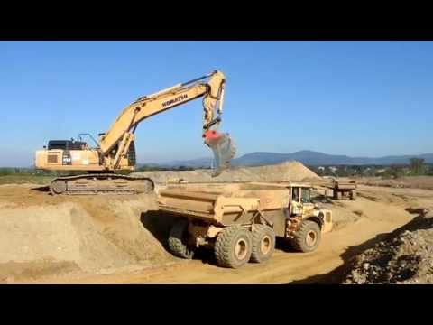 Big excavators on construction sites...Cat, Komatsu, Liebherr...