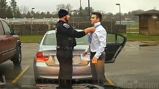 Dashcam: Police Officer Helps Speeding Student Tie His Tie