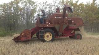 Massey Harris 90 combine with International WD-9 tractor