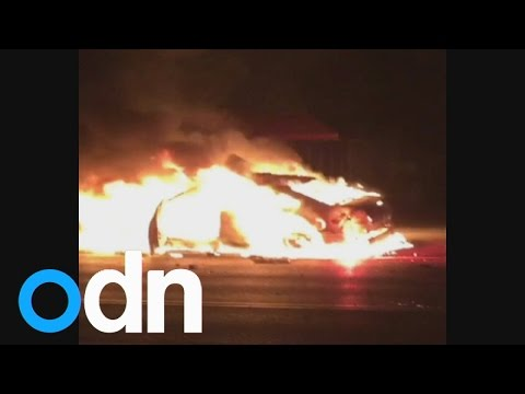 Ferguson: Tear gas fired at protesters and police cars set on fire