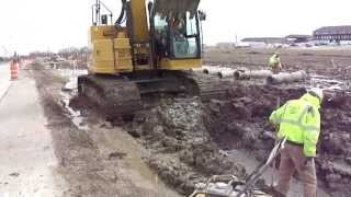 CAT 328DLCR Installing Storm Sewer with a CAT 430E for Support.