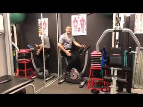 Stationary exercise bike for knee rehabilitation