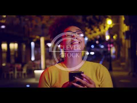 Happy Curly Urban Woman Texting On Phone Traveling Mobile Business Outdoors Slow Motion Red Epic 8k