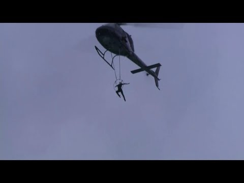 Erendira Wallenda hangs by teeth from chopper over Niagara Falls