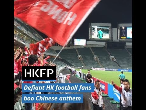 Defiant Hong Kong football fans boo Chinese national anthem at Asian Cupmatch against Lebanon