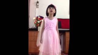 Little cute Asian girl sings let it go from Frozen