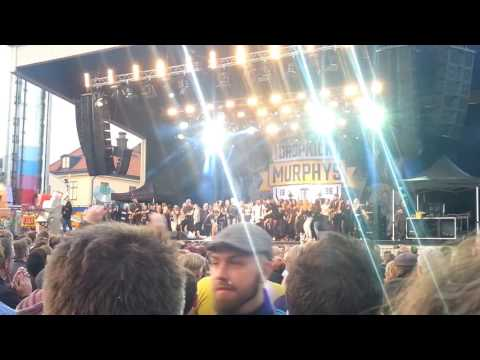 Dropkick Murphys whit ladies on stage in Stockholm 2016.