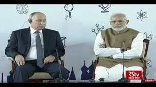 PM Modi and Russian President Vladimir Putin interact with a group of children