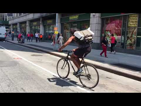 CHEAT DEATH NYC founder Gabe riding through Manhattan