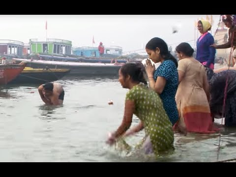 People bathing in the Ganges river HD stock video footage