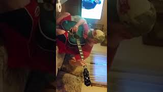 Son tryin out my new guitar from musicians friend