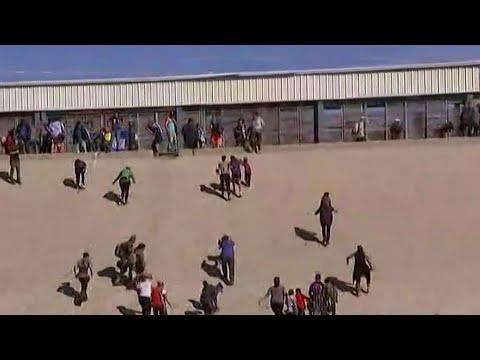 Migrants Storm U.S. Border | MSNBC