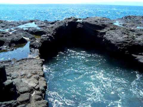 Black volcanic rock near black sands Bali