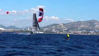 Foiling kiteboard versus the foiling GC32 catamarans
