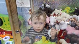 3 year old stuck in an amusement game.