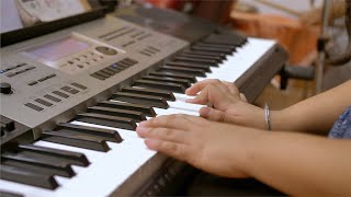 Shot of young girl playing electric piano in the music room